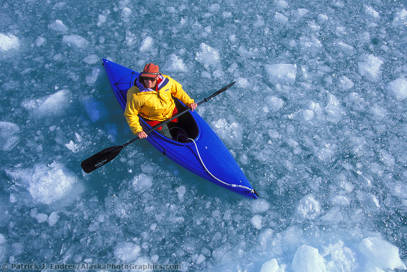 Kayaker in brash ice, Meares glacier, Prince William Sound, Alaska