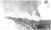 Five engines pushing Rotary #2 across Trout Lake trestle.<br /> RGS  Trout Lake, CO  1916