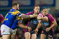 Picture by Allan McKenzie/SWpix.com - 08/02/2018 - Rugby League - Betfred Super League - Leeds Rhinos v Hull KR - Elland Road, Leeds, England - Adam Cuthbertson attempts to tackle Adam Quinlan.