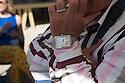 Visitor at Fuorisalone wearing a big watch in Ventura street, Milano April 14, 2016. &copy; Carlo Cerchioli<br /> <br /> Visitatrice del Fuorisalone con un grosso orologio in via Ventura, Milno 14 aprile.