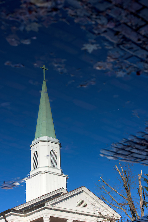 The Church of the Good Shepherd, an Episcopal Parish on Ohio University's campus, is reflected in the street below on November 12, 2016.