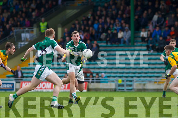 Listry's Anthony Kennedy and Aaron McCarthy in action against Castlegregory in the Kerry County Junior Championship on Sunday in Austin Stack Park on Sunday.