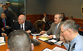 United States Secretary of Defense Donald H. Rumsfeld (center) chairs an operational update on the progress of Operation Iraqi Freedom at the Pentagon on April 8, 2003.  Vice President Dick Cheney (left) and Chairman of the Joint Chiefs of Staff Gen. Richard B. Myers (right), U.S. Air Force, joined Rumsfeld for the secure video teleconference with field commanders. <br /> Mandatory Credit: Robert D. Ward / DoD via CNP