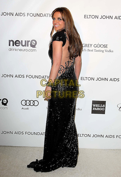 Britney Spears (wearing Michael Cinco Couture).The 21st Annual Elton John AIDS Foundation Academy Awards Viewing Party held at The City of West Hollywood Park in West Hollywood, California, USA..February 24th, 2013.oscars full length black dress sequins back behind rear sheer backless detail looking over shoulder profile dyed brown hair brunette .CAP/ADM/KB.©Kevan Brooks/AdMedia/Capital Pictures.