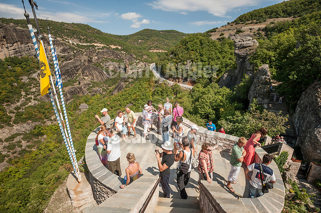 Tourists and pilgrims visit The Holy Monastery of Rousanou/St. Barbara, Meteora, Greece