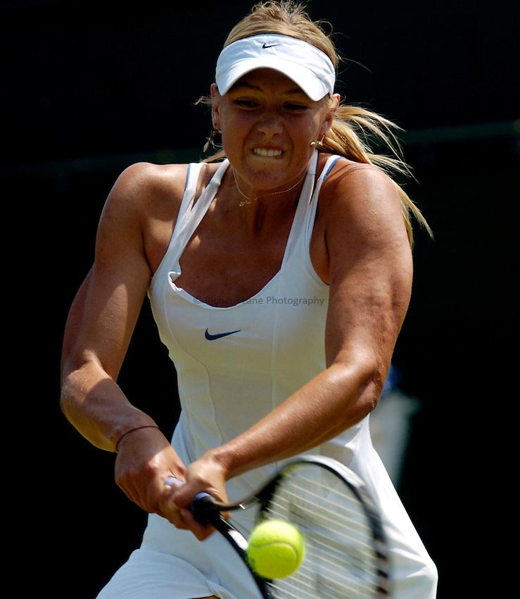 Photo: Richard Lane..Wimbledon Championships. 03/07/2006. .Maria Sharapova of Russia returns.