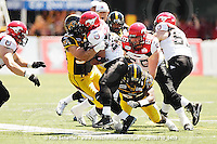 July 10, 2010; Hamilton, ON, CAN; Hamilton Tiger-Cats defensive tackle Matt Kirk (93) tackles Calgary Stampeders running back Joffrey Reynolds (21). CFL football: Calgary Stampeders vs. Hamilton Tiger-Cats at Ivor Wynne Stadium. The Tiger-Cats lost against the Stampeders 23-22. Mandatory Credit: Ron Scheffler. Copyright (c) 2010 Ron Scheffler.