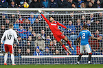 Wes Foderingham makes a save for Rangers