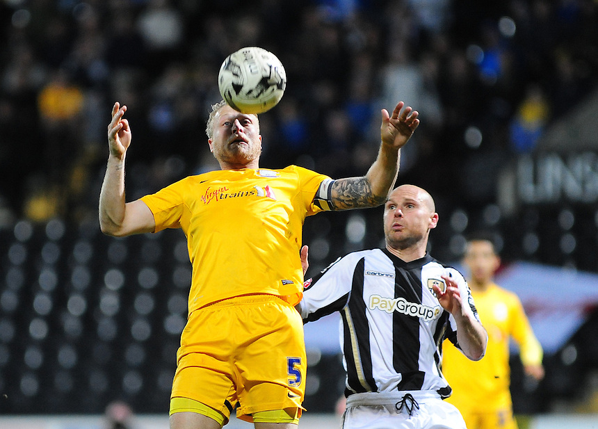 Preston North End's Tom Clarke brings the ball under control while under pressure from Notts County's Gary Jones<br /> <br /> Photographer Andrew Vaughan/CameraSport<br /> <br /> Football - The Football League Sky Bet League One - Notts County v Preston North End - Tuesday 21st April 2015 - Meadow Lane - Nottingham<br /> <br /> &copy; CameraSport - 43 Linden Ave. Countesthorpe. Leicester. England. LE8 5PG - Tel: +44 (0) 116 277 4147 - admin@camerasport.com - www.camerasport.com