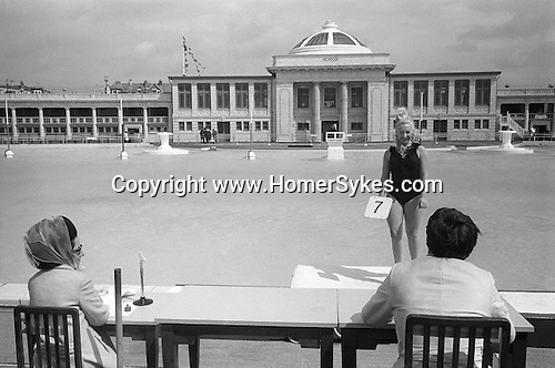 Blackpool Lido summer season beauty competition contestant lines up to be judged. Lancashire England 1970