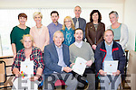 Weeshie Fogarty presents the certificates to the three winners at the Adult Literacy awards in Killarney on Thursday front row l-r: Kathleen O'Brien, Weeshie Fogarty, John O'Sullivan, Padraig O'Leary. Back row: Elaine Clifford KETB, Kathleen Rice Eamon Collier Killarney Library, Aoife McCormack KETB, Tommy O'Connor County librarian, Siobhain Randles Eagers and Mary Concannon