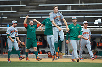 Slade Cecconi (21) of the Miami Hurricanes reacts to a home run hit by teammate Chad Crosbie (not pictured) during the game against the Wake Forest Demon Deacons at David F. Couch Ballpark on May 11, 2019 in  Winston-Salem, North Carolina. The Hurricanes defeated the Demon Deacons 8-4. (Brian Westerholt/Four Seam Images)