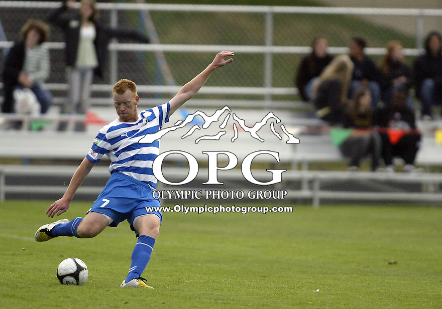 19 June 2009:   Kitsap Pumas mid fielder #7 Stephen Mohn kicks the ball up field against the Victoria Highlanders at Memorial Stadium in Bremerton, WA.  The Kitsap Pumas won 2-1 over the Victoria Highlanders.