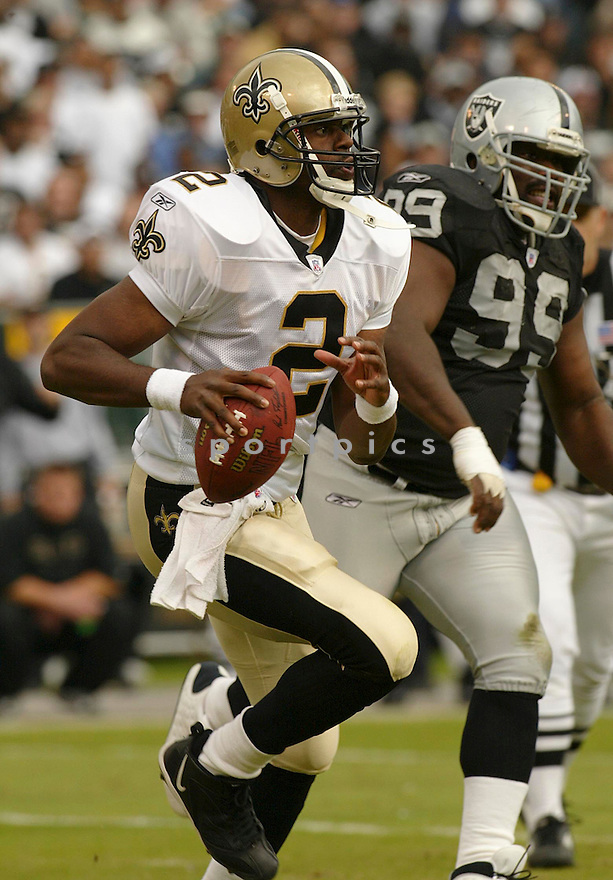 Aaron Brooks during the New Orleans Saints v. Oakland Raiders game on October 17, 2004..Saints win 31-26..Rob Holt / SportPics