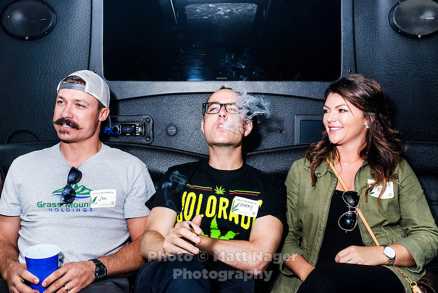 Reporter Harry Wallop smokes a joint with Jon Grant (left) and Niki Grant (right) on a Colorado Cannabis Tour for a marijuana tour to Medicine Man grow facility in Denver, Colorado, Friday, September 30, 2016. <br /> <br /> Photo by Matt Nager