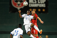 Washington, D.C.- May 29, 2014. Honduras defender Maynor Figueroa heads the ball against Turkey forward Mustafa Pektemek.  Turkey defeated Honduras 2-0 during an international friendly game at RFK Stadium.