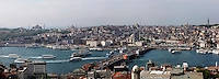 High angle panoramic view of Galata Bridge, 1994, Golden Horn, Istanbul, Turkey, at sunrise. The Galata bridge, the fifth between Karakoy and Eminonu,, was built by STFA and designed and supervised by GAMB. It is a 490 m long bascule bridge, with a main span of 80 m, and a 42 m wide deck and has 3 traffic lanes and one walkway in each direction plus tram tracks connecting suburban  Zeytinburnu to Kabatas. Picture by Manuel Cohen.