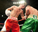 GLASGOW, SCOTLAND - MARCH 10: Paul Appleby of Scotland and Stephen Ormond of Ireland exchange blows during the Vacant Celtic Super-Featherweight Championship bout at the Braehead Arena on March 10, 2012 in Glasgow, Scotland. (Photo by Rob Casey/Getty Images)