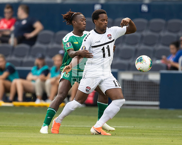 KANSAS CITY, KS - JUNE 26: Daniel Kadell #3 defends against Levi Garcia #11 during a game between Guyana and Trinidad