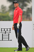 Robert Karlsson (SWE) tees off the 4th tee during Thursday's Round 1 of the 2014 BMW Masters held at Lake Malaren, Shanghai, China 30th October 2014.<br /> Picture: Eoin Clarke www.golffile.ie