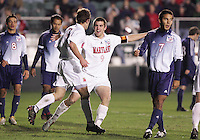 Maryland's Jason Garey (9) embraces teammate Stephen King after King's penalty kick at 49:01 gave Maryland a 4-0 lead. The University of Maryland Terrapins defeated the Southern Methodist University Mustangs 4-1 in a Men's College Cup Semifinal at SAS Stadium in Cary, NC, Friday, December 9, 2005.