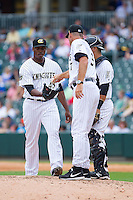 Charlotte Knights manager Joel Skinner (37) gives the ball to relief pitcher Donnie Veal (46) during the game against the Pawtucket Red Sox at BB&T Ballpark on August 10, 2014 in Charlotte, North Carolina.  The Red Sox defeated the Knights  6-4.  (Brian Westerholt/Four Seam Images)