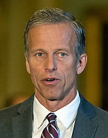 United States Senator John Thune (Republican of South Dakota), center, speaks to reporters following the Republican Party luncheon in the United States Capitol in Washington, DC on Tuesday, July 11, 2017. Photo Credit: Ron Sachs/CNP/AdMedia
