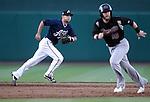 Sacramento River Cats' Daric Barton runs past Reno Aces shortstop Chris Owings during a minor league baseball game in Reno, Nev., on Wednesday, June 12, 2013. Sacramento won 9-7.<br /> Photo by Cathleen Allison