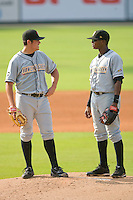 Starting pitcher Matt Moore #36 of the Bowling Green Hot Rods discusses the game situation with shortstop Tim Beckham #26 at Fieldcrest Cannon Stadium August 23, 2009 in Kannapolis, North Carolina. (Photo by Brian Westerholt / Four Seam Images)