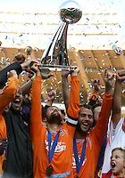 Houston captain Wade Barrett lifts the trophy surrounded by his teammates. The Houston Dynamo defeated the New England Revolution 2-1 in the finals of the MLS Cup at RFK Memorial Stadium in Washington, D. C., on November 18, 2007.