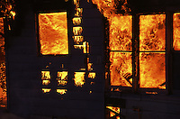 Fire consumes a donated house at the end of a day of training for the Central Mat-Su Fire Department.