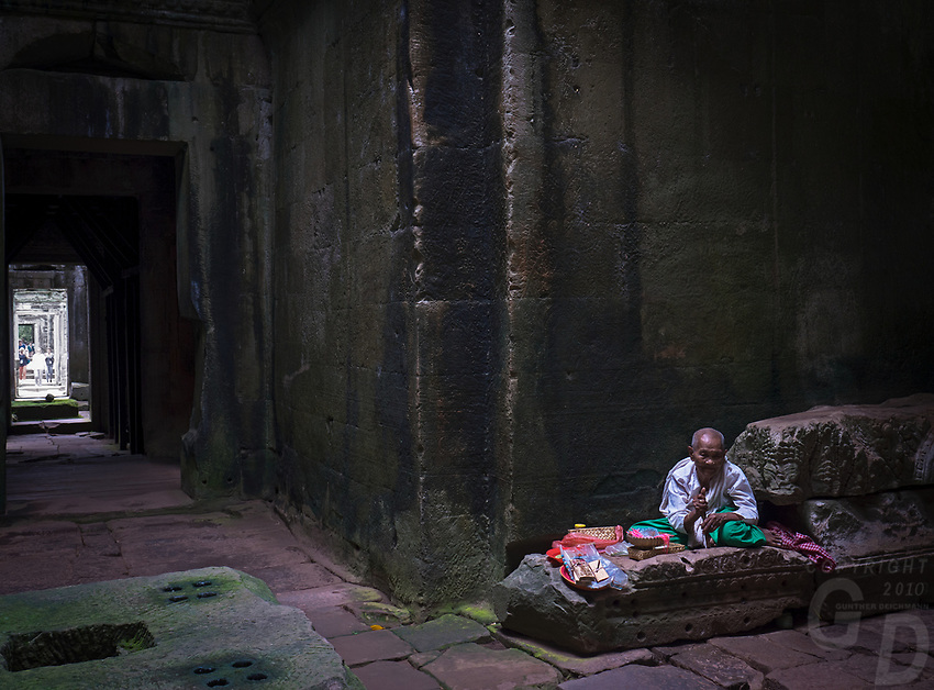 Buddhist Nun in the corridors of Preah Khan, Angkor, Siem Reap, Cambodia