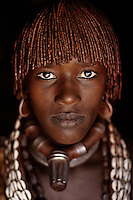Omo Valley, Ethiopia, 2006 . Goite, women from Hamer tribe with her baby at her house.