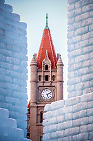 2018 Saint Paul Winter Carnival Ice Palace with Landmark Center clock tower. The ice palace was built in Rice Park downtown St. Paul, Minnesota.