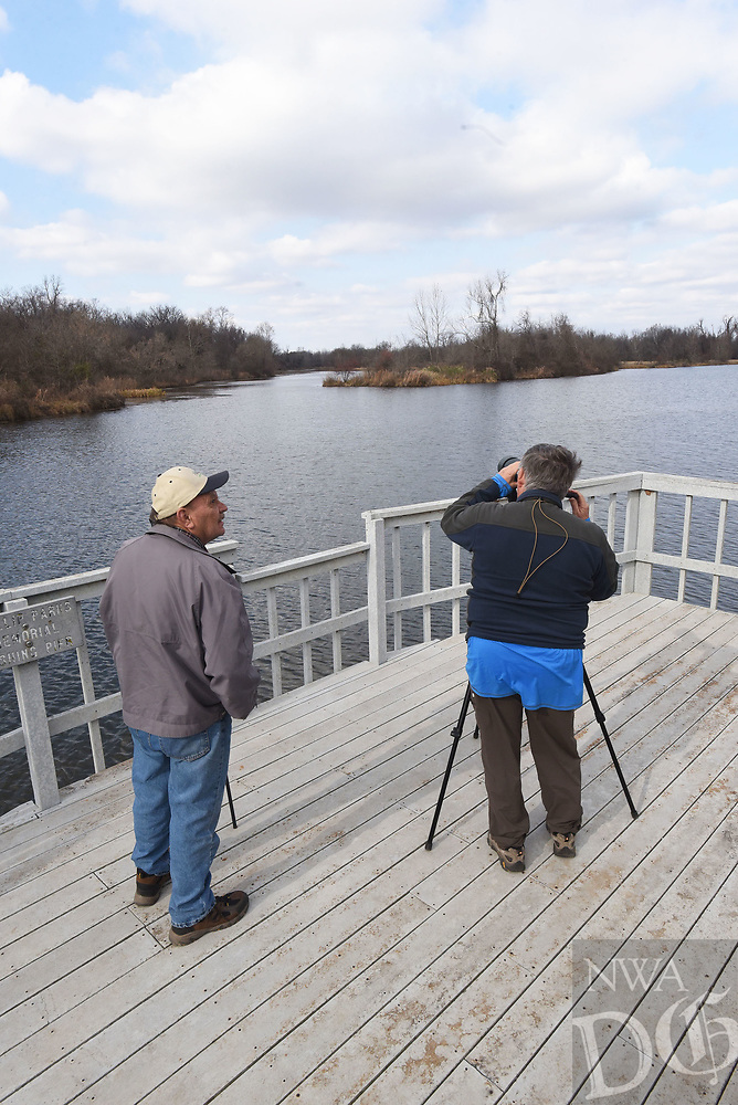 NWA Democrat-Gazette/FLIP PUTTHOFF <br /> Terry Stanfill (left) and Joe Neal look at birds on Reeve's Slough, a backwater off the Arkansas River, at Sequoyah National Wildlife Refuge. A boat ramp offers access to the slough that beckons paddlers in kayaks or canoes.