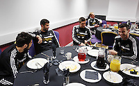 Wednesday, 23 April 2014<br /> Pictured L-R: Alejandro Pozuelo, Jordi Amat, Pablo Hernansez and Alvaro Zazquez in the breakfast room.<br /> Re: Swansea City FC are holding an open training session for their supporters at the Liberty Stadium, south Wales,