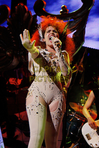 PALOMA FAITH .Performing Live in concert as part of the iTunes Festival 2010,  The Roundhouse, London, England, UK, July 7th 2010..music concert gig on stage half length microphone singing cream beige suit costume suspenders stockings leotard body suit studded studs embellished hand camel toe wings ears .CAP/MAR.© Martin Harris/Capital Pictures.