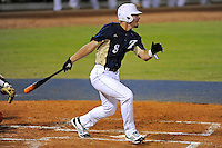 2 March 2012:  FIU utility player Oscar Aguirre (8) hits early in the game as the FIU Golden Panthers defeated the Brown University Bears, 6-5, at University Park Stadium in Miami, Florida.