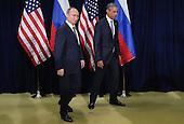 President Valdimir Putin of Russia (L) and United States President Barack Obama leave after posing for the cameras before the start of a bilateral meeting at the United Nations headquarters September 28, 2015 in New York City. Putin and Obama are in New York City to attend the 70th anniversary general assembly meetings. <br /> Credit: Chip Somodevilla / Pool via CNP