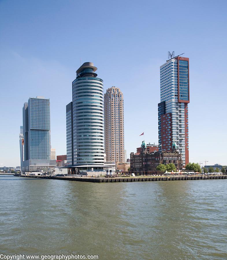 Historic Hotel New York building dwarfed by modern skyscrapers, Rotterdam, Netherlands