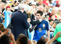 Lionel Messi of Argentina shows a look of dejection as he collects his Golden Ball award for player of the tournament