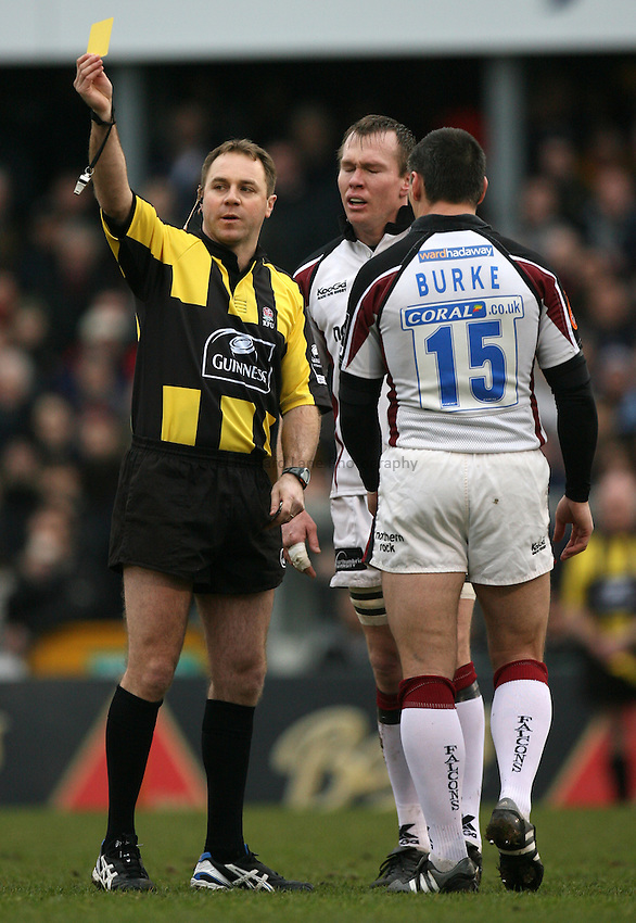 Photo: Rich Eaton...Bristol Rugby v Newcastle Falcons. Guinness Premiership. 18/02/2007. referee Andrew Small gives a yellow card to Russell Winter of Newcastle, centre watched by his captain Matthew Burke