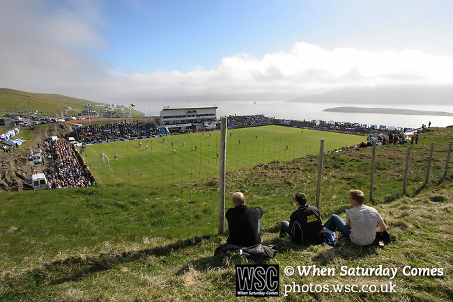 Faroe Islands 0 Scotland 2, 06/06/2007. Svangaskard, Toftir, Euro 2008 Qualifying. Three Faroese fans watching the action from the hillside outside the ground as the Faroe Islands take on Scotland in a Euro 2008 group B qualifying match at the Svangaskard stadium in Toftir. The visitors won the match by 2 goals to nil to stay in contention for a place at the European football championships which were to be held in Switzerland and Austria in the Summer of 2008. It was the first time Scotland had won in the Faroes, the previous two matches ended in draws. Photo by Colin McPherson.