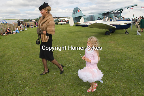 Goodwood Festival of Speed. Goodwood Sussex. UK. Woman in retro clothes air display.