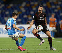 12th July 2020; Stadio San Paolo, Naples, Campania, Italy; Serie A Football, Napoli versus AC Milan; Zlatan Ibrahimovic of AC Milan controls the ball as Piotr Zieliński of Napoli closes in