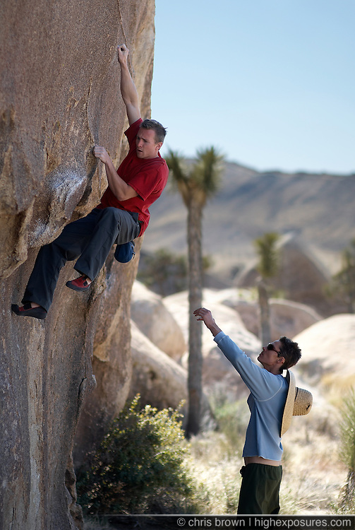 Christian Tartaglia climbs a boulder in Joshua Tree National Park.