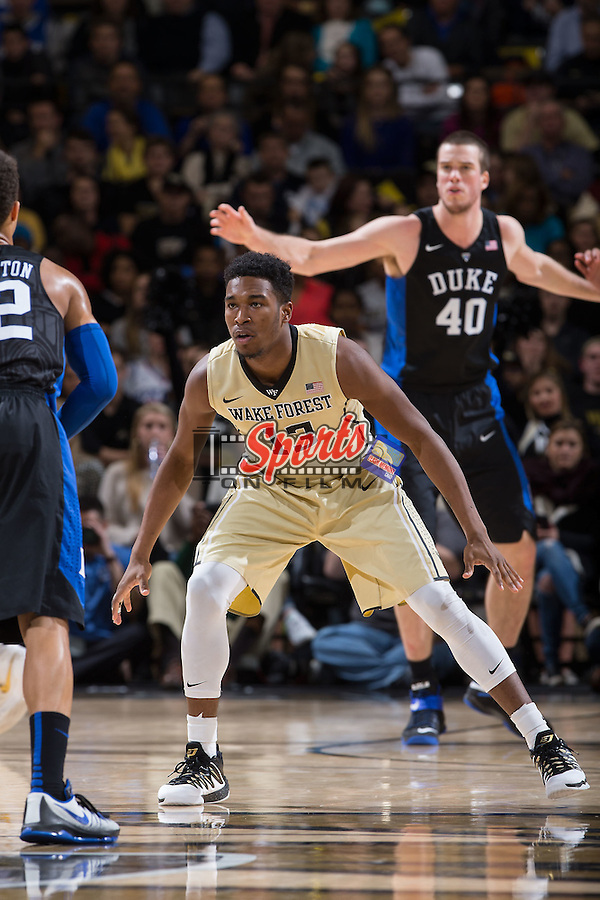Bryant Crawford (13) of the Wake Forest Demon Deacons on defense during second half action against the Duke Blue Devils at the LJVM Coliseum on January 6, 2016 in Winston-Salem, North Carolina.  The Blue Devils defeated the Demon Deacons 91-75.  (Brian Westerholt/Sports On Film)
