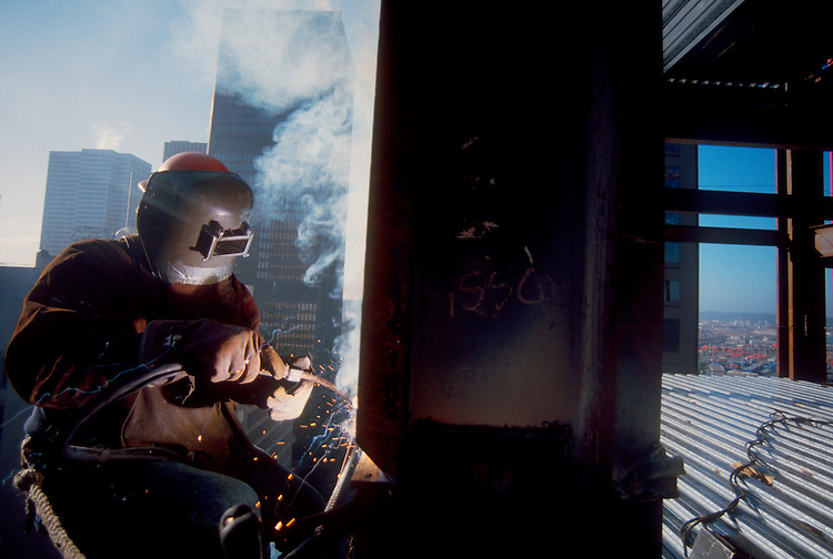 Welder, Seattle, high rise office building under construction, Washington State, Pacific Northwest, USA.