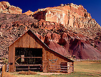 Capitol Reef National Park, UT  <br /> Open doors of the Gifford barn at Fruita under the red cliffs of Capitol Reef