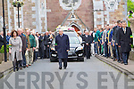 The Funeral of Teddy Dowd flanked by a gaurd of honour by John Mitchels GAA club leaves Saint Johns Church Castle Street on Tuesday.